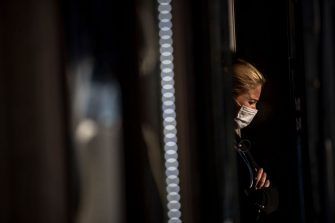ROME, ITALY - OCTOBER 07: A woman wearing a protective mask walks at Via del Corso amid Covid-19 pandemic, on October 07, 2020 in Rome, Italy. Today Italian Prime Minister Giuseppe Conte set an order to make the wearing of face masks in outdoor spaces mandatory due to the increase of Covid-19 cases in Italy. Today there has been an increase in new COVID-19 cases in Italy with the number rising to 3678 for the first time in months. (Photo by Antonio Masiello/Getty Images)