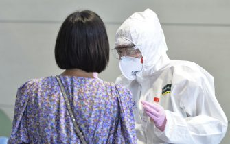 TURIN, ITALY - AUGUST 19: A woman undergoes a swab test for Covid-19 at Turin airport on August 19, 2020 in Turin, Italy. The Italian government is requiring people arriving from high-risk designated countries to take a Covid-19 test, which includes regions in Spain, Greece, Croatia and Malta. According to the Ministry of Health, Coronavirus infection rates are climbing again in Italy from an average of 400 new cases per day. Authorities see Italian returning from vacation abroad as a likely strong contributor to the uptick in infections. (Photo by Diego Puletto/Getty Images)