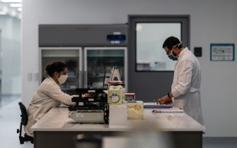 epa08603484 Workers of the mAbxience laboratory, chosen by AstraZeneca for the production in Latin America of the vaccine against COVID-19, carry out tasks in the plant that the company owns in Garin, in the province of Buenos Aires, Argentina, 14 August 2020. The Argentine laboratory mAbxience is confident that the results of the clinical trial of the vaccine developed by AstraZeneca in collaboration with the British University of Oxford will be positive and that production will begin later this year or early 2021.  EPA/Juan Ignacio Roncoroni