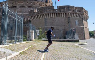 A runner leaves the public park next to Castel Sant Angelo, in the first day of phase two during the coronavirus lockdown in Rome, Italy, 4 May 2020.   MAURIZIO BRAMBATTI/ANSA