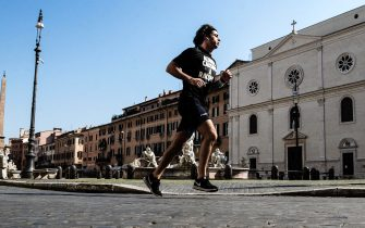 A runner in Piazza Navona empties on Easter holiday during the emergency blockade of the Coronavirus Covid-19 in Rome, Italy, 12 April 2020. ANSA/ANGELO CARCONI