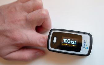 Close-up of human hand using a home pulse oximeter from Innovo to measure heartbeat and blood oxygen saturation, San Ramon, California, April 25, 2020. Pulse oximeters are often used in homecare for respiratory illnesses including the COVID-19 coronavirus. (Photo by Smith Collection/Gado/Getty Images)