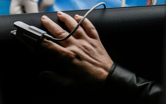 A person in her car suspected of COVID-19 infection undergoes level of oxygen measuring with a pulse oxymeter as she lines up waiting to access the entrance to the infectious diseases emergency unit at the Cotugno hospital in Naples on November 12, 2020 amid a surge of COVID-19 cases in Naples overwhelming hospitals. - The Italian government imposed tighter restrictions on another five regions on November 10 as it tries to stem escalating new cases of coronavirus, while still resisting a nationwide lockdown. (Photo by Filippo MONTEFORTE / AFP) (Photo by FILIPPO MONTEFORTE/AFP via Getty Images)
