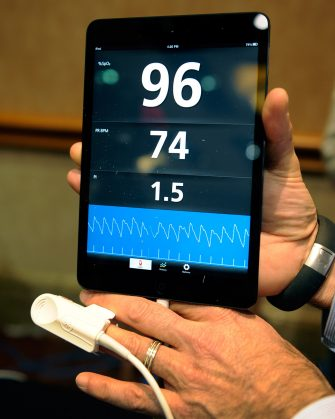 LAS VEGAS, NV - JANUARY 06:  An iSpO2 pulse oximeter is on display at a press event at the Mandalay Bay Convention Center for the 2013 International CES on January 6, 2013 in Las Vegas, Nevada. The USD 249 personal health monitor attaches to the user's mobile device that can record, save and transmit vital statistics. CES, the world's largest annual consumer technology trade show, runs from January 8-11 and is expected to feature 3,100 exhibitors showing off their latest products and services to about 150,000 attendees.  (Photo by David Becker/Getty Images)