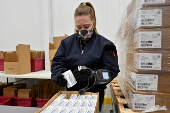 epa09044945 An employee with the McKesson Corporation scans a box of the Johnson and Johnson COVID-19 vaccine as she fills an order at their shipping facility in Shepherdsville, Kentucky, USA, 01 March 2021. US Food and Drug Administration (FDA) on 27 February approved Johnson & Johnson single dose coronavirus vaccine, of which 3.9 doses will be distributed all over US.  EPA/TIMOTHY D. EASLEY / POOL
