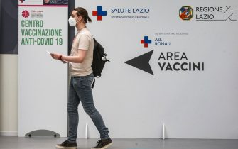 Alessandro, 30, gets vaccinated in the Acea vaccination center on the occasion of the Â?Â?Open week vaccinationÂ?Â?, with Astrazeneca, for all over the age of 18, launched by the Lazio region from 2 to 6 June, Rome 3 June 2021. ANSA/FABIO FRUSTACI