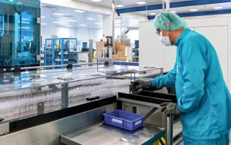 epa08688482 A handout photo made available by Sanofi shows an employee in the production of a possible Covid-19 vaccine in Frankfurt am Main, Germany, 15 September 2020 (issued 22 September 2020). The pharmaceutical company Sanofi officially started the production of its potential vaccine against COVID-19 in Frankfurt on 22 September 2020 to ensure that protection against corona infection is immediately available at the time of approval. According to Sanofi, clinical testing of this vaccine candidate began in early September. If all clinical testings are successful, Sanofi expects application for approval oft he vaccine in the first half of 2021.  EPA/MARTIN JOPPEN / SANOFI / HANDOUT  HANDOUT EDITORIAL USE ONLY/NO SALES