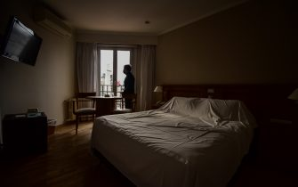 BUENOS AIRES, ARGENTINA - JULY 01: Daniel Muñoz, owner of Bristol Hotel, looks to the Obelisk trough the window of and empty room  during the lockdown on July 01, 2020 in Buenos Aires, Argentina. In April, the activity in hotels dropped up to 85%, due to travel and circulation restrictions to halt coronavirus spread. Some places host patients with COVID-19 after an agreement with local authorities and some remain closed. According to the national statistics bureau (INDEC), economy in Argentina shrank 26% year on year in April, the first full month of coronavirus lockdown. Due to increasing number of cases in Buenos Aires Aires metropolitan, authorities tightened restrictions allowing only essential shops and industries to remain open to public. Apart from dealing with the pandemic, Argentina is on default and holds a negotiation with creditors to restructure a 66 billion USD debt. (Photo by Amilcar Orfali/Getty Images)