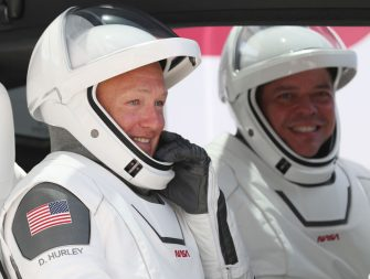 CAPE CANAVERAL, FLORIDA - MAY 30: NASA astronauts Bob Behnken (R) and Doug Hurley sit in a Tesla vehicle after walking out of the Operations and Checkout Building on their way to the SpaceX Falcon 9 rocket with the Crew Dragon spacecraft on launch pad 39A at the Kennedy Space Center on May 30, 2020 in Cape Canaveral, Florida. The inaugural flight will be the first manned mission since the end of the Space Shuttle program in 2011 to be launched into space from the United States. (Photo by Joe Raedle/Getty Images)