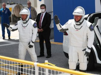 CAPE CANAVERAL, FLORIDA - MAY 30: NASA astronauts Bob Behnken (R) and Doug Hurley say goodbye to family members after walk ing out of the Operations and Checkout Building on their way to the SpaceX Falcon 9 rocket with the Crew Dragon spacecraft on launch pad 39A at the Kennedy Space Center on May 30, 2020 in Cape Canaveral, Florida. The inaugural flight will be the first manned mission since the end of the Space Shuttle program in 2011 to be launched into space from the United States. (Photo by Joe Raedle/Getty Images)