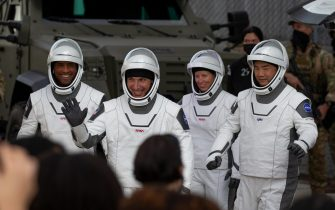 epaselect epa08823119 The SpaceX crew members, NASA astronauts (L-R), Victor Glover, Mike Hopkins, Shannon Walker and Japan Aerospace Exploration Agency (JAXA) astronaut Soichi Noguchi wave as they exit the Neil A. Armstrong Operations and Checkout Building enroute to the Falcon 9 rocket at Launch Complex 39A at the John F. Kennedy Space Center, on Merritt Island, Cape Canaveral, Florida, USA, 15 November 2020. The Crew-1 astronauts, aboard the spacecraft named  'Resilience' are to rendezvous with the ISS on 16 November 2020.  EPA/CJ GUNTHER