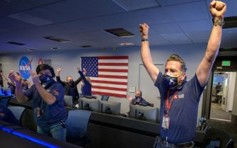 epa09022630 A handout photo made available by NASA shows Members of NASA's Perseverance rover team react in mission control after receiving confirmation the spacecraft successfully touched down on Mars, at NASA's Jet Propulsion Laboratory in Pasadena, California, USA, 18 February 2021. A key objective for Perseverance's mission on Mars is astrobiology, including the search for signs of ancient microbial life. The rover will characterize the planet's geology and past climate, pave the way for human exploration of the Red Planet, and be the first mission to collect and cache Martian rock and regolith.  EPA/NASA/BILL INGALLS / HANDOUT MANDATORY CREDIT: (NASA) HANDOUT EDITORIAL USE ONLY/NO SALES