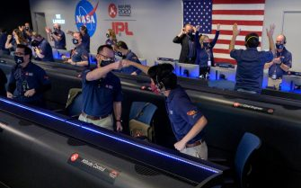 epa09022966 A handout photo made available by NASA shows members of NASA s Perseverance rover team reacting in mission control after receiving confirmation the spacecraft successfully touched down on Mars, at NASA's Jet Propulsion Laboratory in Pasadena, California, USA, 18 February 2021. A key objective for Perseverance's mission on Mars is astrobiology, including the search for signs of ancient microbial life. The rover will characterize the planet's geology and past climate, pave the way for human exploration of the Red Planet, and be the first mission to collect and cache Martian rock and regolith.  EPA/NASA/BILL INGALLS HANDOUT MANDATORY CREDIT: (NASA/BILL INGALLS) HANDOUT EDITORIAL USE ONLY/NO SALES