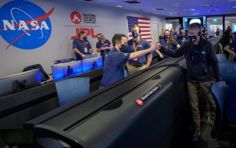 epa09022967 A handout photo made available by NASA shows members of NASA s Perseverance rover team reacting in mission control after receiving confirmation the spacecraft successfully touched down on Mars, at NASA's Jet Propulsion Laboratory in Pasadena, California, USA, 18 February 2021. A key objective for Perseverance's mission on Mars is astrobiology, including the search for signs of ancient microbial life. The rover will characterize the planet's geology and past climate, pave the way for human exploration of the Red Planet, and be the first mission to collect and cache Martian rock and regolith.  EPA/NASA/BILL INGALLS HANDOUT MANDATORY CREDIT: (NASA/BILL INGALLS) HANDOUT EDITORIAL USE ONLY/NO SALES
