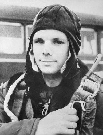 Russian Air Force Major Yuri Gagarin, age 27, became the first man in space on April 12, 1961. Gagarin was orbited around the earth and returned safely.