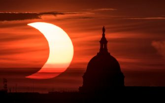 epa09259307 A handout picture made available by the National Aeronautics and Space Administration (NASA) shows a partial solar eclipse as the sun rises to the left of the United States Capitol Building, 10 June 2021, as seen from Arlington, Virginia. The annular or  ring of fire  solar eclipse is only visible to some people in Greenland, Northern Russia, and Canada.  EPA/NASA HANDOUT / Bill Ingalls  HANDOUT EDITORIAL USE ONLY/NO SALES