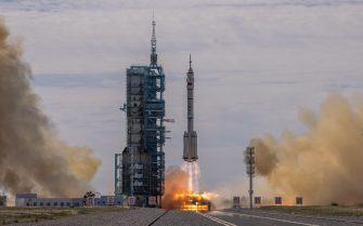 epa09278499 The Long March-2F carrier rocket, carrying the Shenzhou-12, takes off from the launch site at the Jiuquan Satellite Launch Center, in the Gobi Desert, Inner Mongolia, near Jiuquan, China, 17 June 2021. China launched the Shenzhou-12 spacecraft carrying three crew members Tang Hongbo, Nie Haisheng, and Liu Boming to the orbiting Tianhe core module for a three-month mission on 17 June. The mission is China's first manned spaceflight in almost five years.  EPA/ROMAN PILIPEY