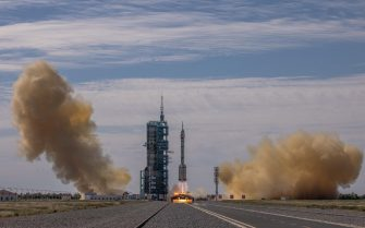 epa09278500 The Long March-2F carrier rocket, carrying the Shenzhou-12, takes off from the launch site at the Jiuquan Satellite Launch Center, in the Gobi Desert, Inner Mongolia, near Jiuquan, China, 17 June 2021. China launched the Shenzhou-12 spacecraft carrying three crew members Tang Hongbo, Nie Haisheng, and Liu Boming to the orbiting Tianhe core module for a three-month mission on 17 June. The mission is China's first manned spaceflight in almost five years.  EPA/ROMAN PILIPEY