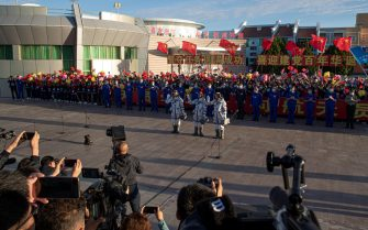 epa09278432 Chinese astronauts Tang Hongbo, Nie Haisheng, and Liu Boming wave during a departure ceremony before the launch of the Long March-2F carrier rocket, carrying the Shenzhou-12 at the Jiuquan Satellite Launch Center, in the Gobi Desert, northwest of China, 17 June 2021. China launches Shenzhou-12 spacecraft carrying three crew members Tang Hongbo, Nie Haisheng, and Liu Boming to the orbiting Tianhe core module for a three-month mission on 17 June. It is the first spaceflight in almost five years where China sends humans into space.  EPA/ROMAN PILIPEY