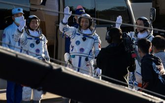 epa09278428 Chinese astronauts Tang Hongbo, Nie Haisheng, and Liu Boming wave during a departure ceremony before the launch of the Long March-2F carrier rocket, carrying the Shenzhou-12 at the Jiuquan Satellite Launch Center, in the Gobi Desert, northwest of China, 17 June 2021. China launches Shenzhou-12 spacecraft carrying three crew members Tang Hongbo, Nie Haisheng, and Liu Boming to the orbiting Tianhe core module for a three-month mission on 17 June. It is the first spaceflight in almost five years where China sends humans into space.  EPA/ROMAN PILIPEY