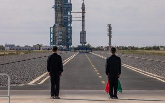 epa09278523 The Long March-2F carrier rocket, carrying the Shenzhou-12, is seen before the launch at the launch site at the Jiuquan Satellite Launch Center, in the Gobi Desert, Inner Mongolia, near Jiuquan, China, 17 June 2021. China launched the Shenzhou-12 spacecraft carrying three crew members Tang Hongbo, Nie Haisheng, and Liu Boming to the orbiting Tianhe core module for a three-month mission on 17 June. The mission is China's first manned spaceflight in almost five years.  EPA/ROMAN PILIPEY