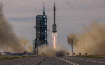 epa09278524 The Long March-2F carrier rocket, carrying the Shenzhou-12, takes off from the launch site at the Jiuquan Satellite Launch Center, in the Gobi Desert, Inner Mongolia, near Jiuquan, China, 17 June 2021. China launched the Shenzhou-12 spacecraft carrying three crew members Tang Hongbo, Nie Haisheng, and Liu Boming to the orbiting Tianhe core module for a three-month mission on 17 June. The mission is China's first manned spaceflight in almost five years.  EPA/ROMAN PILIPEY