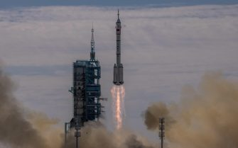 epa09278507 The Long March-2F carrier rocket, carrying the Shenzhou-12, takes off from the launch site at the Jiuquan Satellite Launch Center, in the Gobi Desert, Inner Mongolia, near Jiuquan, China, 17 June 2021. China launched the Shenzhou-12 spacecraft carrying three crew members Tang Hongbo, Nie Haisheng, and Liu Boming to the orbiting Tianhe core module for a three-month mission on 17 June. The mission is China's first manned spaceflight in almost five years.  EPA/ROMAN PILIPEY