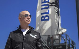 epa09252931 An undated handout photo made available by Blue Origin shows Blue Origin founder Jeff Bezos inspects New Shepard s West Texas launch facility before the rocket s maiden voyage, in West Texas, USA. (issued 07 June 2021). Outgoing Amazon CEO Jeff Bezos via social media on 07 June 2021 announced he and his brother will be on Bezos's space company Blue Origin's first crewed space flight. One seat on the flight scheduled for 20 July 2021 is auctioned.  EPA/BLUE ORIGIN HANDOUT MANDATORY CREDIT: BLUE ORIGIN HANDOUT EDITORIAL USE ONLY/NO SALES