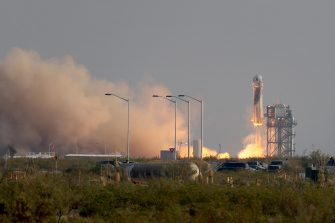 VAN HORN, TEXAS - JULY 20:  The New Shepard Blue Origin rocket lifts-off from the launch pad carrying Jeff Bezos along with his brother Mark Bezos, 18-year-old Oliver Daemen, and 82-year-old Wally Funk prepare to launch on July 20, 2021 in Van Horn, Texas. Mr. Bezos and the crew are riding in the first human spaceflight for the company.   (Photo by Joe Raedle/Getty Images)