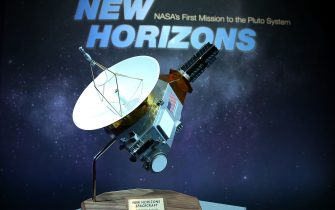 LAUREL, MD - JULY 15:  A model of the New Horizons spacecraft that passed with 7,800 miles of Pluto yesterday, is on display at a NASA news conference July 15, 2015 in Laurel, Maryland. Images from the flyby are being released as they become available. The 1,050-pound piano sized probe, which was launched January 19, 2006 aboard an Atlas V rocket from Cape Canaveral, Florida, zipped by the planet yesterday.  (Photo by Mark Wilson/Getty Images)