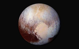 epa06940540 (FILE) - A handout image provided by the National Aeronautics and Space Administration (NASA) on 24 July 2015 shows the dwarf planet Pluto in enhanced color. Scientists used enhanced color images of the New Horizons probe to detect differences in the composition and texture of Pluto's surface. Four images from New Horizons' Long Range Reconnaissance Imager (LORRI) were combined with color data from the Ralph instrument to create this enhanced color global view from a distance of 280,000 miles (450,000 kilometers). Discovered on 18 February 1930 and for a long time considered the ninth and most distant planet to the sun in our solar system, it was reclassified as a 'dwarf planet' by the International Astronomical Union (IAU) on 24 August 2006 after another dwarft planet with a 27 percent bigger mass than Pluto was discovered in the so-called Kuiper belt beyond the planet Neptune. *** Local Caption *** 52653960  EPA/NASA/JHUAPL/SwRI/HANDOUT MANDATORY CREDIT: NASA/JHUAPL/SwRI HANDOUT EDITORIAL USE ONLY *** Local Caption *** 52653960