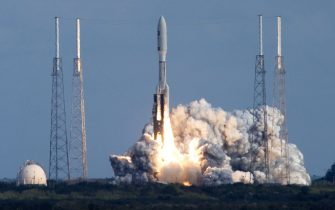 CAPE CANAVERAL, FL - JANUARY 19:  A Lockheed Martin Atlas 5 rocket lifts off of pad 41 carrying NASA's Pluto New Horizons spacecraft at the Kennedy Space Center January 19, 2006 in Cape Canaveral, Florida. The New Horizons mission is scheduled to conduct at five-month reconnaissance study of Pluto and Charon in 2015.  (Photo by Matt Stroshane/Getty Images)