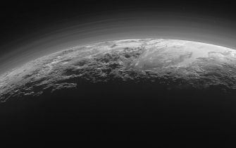 epa06940541 (FILE) - A handout picture made available by NASA on 18 September 2015 and taken by the National Aeronautics and Space Administration's (NASA) New Horizons spacecraft shows a near-sunset view of the rugged, icy mountains and flat ice plains extending to Pluto's horizon, 14 July 2015. The image was taken from a distance of about 18,000 kilometers to Pluto, with a scene of 1,250 kilometers wide. Discovered on 18 February 1930 and for a long time considered the ninth and most distant planet to the sun in our solar system, it was reclassified as a 'dwarf planet' by the International Astronomical Union (IAU) on 24 August 2006 after another dwarft planet with a 27 percent bigger mass than Pluto was discovered in the so-called Kuiper belt beyond the planet Neptune.  EPA/NASA/JHUAPL/SwRI/HANDOUT MANDATORY CREDIT: NASA/JHUAPL/SwRI HANDOUT EDITORIAL USE ONLY *** Local Caption *** 52653960