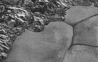 epa06777226 A handout photo made available by NASA on 01 June 2018 shows suspected dunes on Pluto in this image acquired by NASA's New Horizons spacecraft during its 14 July 2015 flyby. An international team of scientists said on 31 May 2018, that dunes, possibly composed of sand-sized grains of solid methane ice, have been identified in the Sputnik Planitia region of the dwarf planet. The team analyzed the images of Pluto taken in 2015 by NASA's New Horizon spacecraft.  EPA/NASA/JHUAPL/SwRI HANDOUT  HANDOUT EDITORIAL USE ONLY/NO SALES