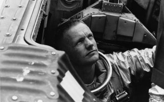 American astronaut Neil Armstrong (1930 - 2012), command pilot for the Gemini 5 backup crew, prepares to close the hatch on the Gemini Static Article 5 spacecraft, during water egress training in the Gulf of Mexico, July 1965. (Photo by NASA/Pictorial Parade/Archive Photos/Getty Images)