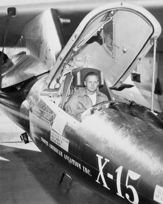 First man on the moon and X-15 NASA pilot Neil Armstrong, sits in aircraft.