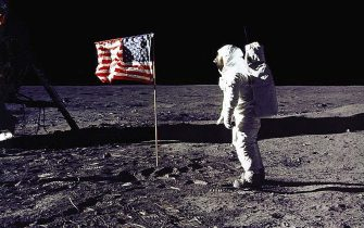 "DC, UNITED STATES:  This 20 July 1969 file photo released by NASA shows astronaut Edwin E. ""Buzz"" Aldrin, Jr. saluting the US flag on the surface of the Moon during the Apollo 11 lunar mission.  The 20th July 1999 marks the 30th anniversary of the Apollo 11 mission and man's first walk on the Moon.          AFP PHOTO   NASA (Photo credit should read NASA/AFP via Getty Images)"