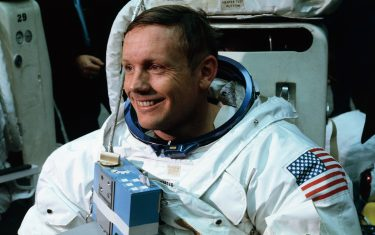 (Original Caption) Space Center, Houston: Astronaut Neil A. Armstrong, in training for the projected Apollo 11 lunar landing mission, is being suited up for the first full dress rehearsal of activities he is to perform during the projected moon landing.