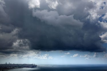 TOPSHOT - A picture taken on May 24, 2020, shows storm clouds forming over the Lebanese capital Beirut. (Photo by PATRICK BAZ / AFP) (Photo by PATRICK BAZ/AFP via Getty Images)
