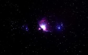This long exposure picture taken late on November 22, 2017 shows the Orion Nebula (C), a diffuse nebula situated in the Milky Way, seen from Wundwin, near the Myanmar city of Mandalay. / AFP PHOTO / YE AUNG THU        (Photo credit should read YE AUNG THU/AFP via Getty Images)