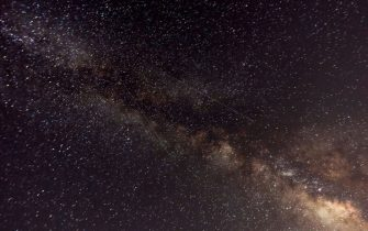 """A picture taken late on August 12, 2018 shows meteors crossing the night sky past the Milky Way during the annual """"Perseid"""" meteor show, in the mountain area of Tannourine in northern Lebanon. (Photo by Joseph EID / AFP)        (Photo credit should read JOSEPH EID/AFP via Getty Images)"""
