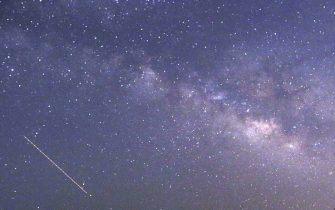 CORRECTION This long-exposure photograph taken on April 23, 2015 on Earth Day shows Lyrids meteors shower passing near the Milky Way in the clear night sky of Thanlyin, nearly 14miles away from Yangon. AFP PHOTO / Ye Aung Thu        (Photo credit should read Ye Aung Thu/AFP via Getty Images)