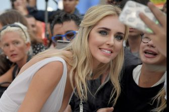 "Actress Chiara Ferragni poses with fans before the premiere of the movie ""Suburbicon"" presented out of competition at the 74th Venice Film Festival on September 2, 2017 at Venice Lido.  / AFP PHOTO / Tiziana FABI        (Photo credit should read TIZIANA FABI/AFP via Getty Images)"