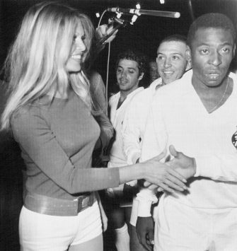Soccer king Pele (right), of Brazil, and other team members meet French film star Brigitte Bardot at Colombes Stadium here March 31st during a charity match between the Santos of Brazil and combined French teams of St. Etienne and Marseille.