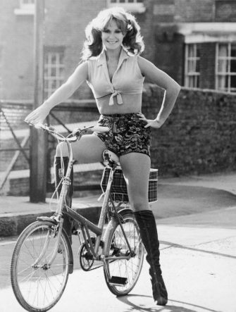English actress Carol Cleveland cycling in hot pants, November 1971. (Photo by D. Morrison/Daily Express/Hulton Archive/Getty Images)