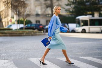 PARIS, FRANCE - JANUARY 21: Leonie Hanne wears a blue ruffled top, a pale blue skirt, a blue Lady Dior bag, Dior pointy shoes, during Paris Fashion Week - Haute Couture Spring/Summer 2020, on January 21, 2020 in Paris, France. (Photo by Edward Berthelot/Getty Images )