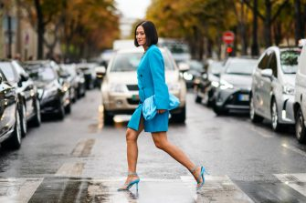 PARIS, FRANCE - OCTOBER 01: Tiffany Hsu wears a blue oversized jacket dress, a blue bag, blue heels shoes, outside Miu Miu, during Paris Fashion Week - Womenswear Spring Summer 2020, on October 01, 2019 in Paris, France. (Photo by Edward Berthelot/Getty Images)