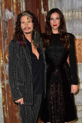 NEW YORK, NY - SEPTEMBER 11:  Steven Tyler and Liv Tyler attend the Givenchy show during Spring 2016 New York Fashion Week at Pier 26 on September 11, 2015 in New York City.  (Photo by Brian Killian/WireImage)