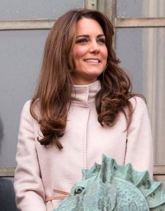 CAMBRIDGE, UNITED KINGDOM - NOVEMBER 28: (EMBARGOED FOR PUBLICATION IN UK NEWSPAPERS UNTIL 48 HOURS AFTER CREATE DATE AND TIME) Catherine, Duchess of Cambridge stands on the balcony of The Guildhall during her and husband Prince William, Duke of Cambridge's first official visit to Cambridge on November 28, 2012 in Cambridge, England.  (Photo by Indigo/Getty Images)