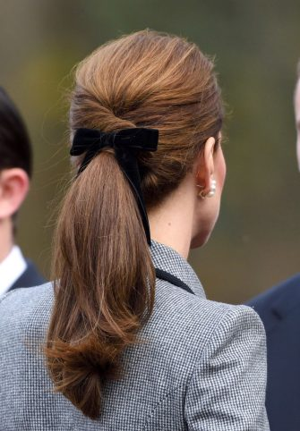 LEICESTER, ENGLAND - NOVEMBER 28:  Catherine, Duchess of Cambridge, hair detail, arrives at Leicester City Football Club to pay tribute to those who were tragically killed in the helicopter crash at the King Power Stadium on November 28, 2018 in Leicester, United Kingdom.  (Photo by Karwai Tang/WireImage)